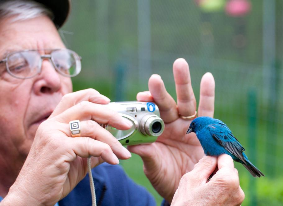 Name:  Larry taking an 'adopt a bird' pic 5-24-11 B.jpg